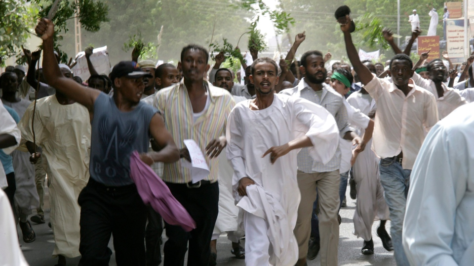 Sudanese protesters chant slogans during a protest in Khartoum, Sudan, Friday, Sept. 14, 2012. (AP / Abd Raouf)