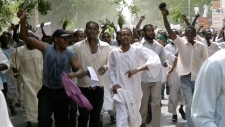 Sudanese protesters chant slogans during a protest in Khartoum, Sudan, Friday, Sept. 14, 2012