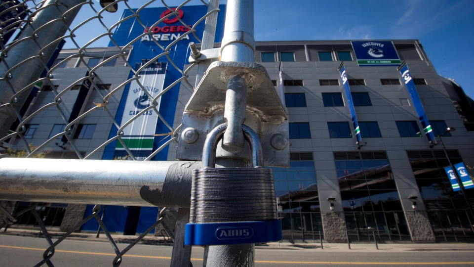 A padlock is seen on the gate of a parking lot outside Rogers Arena, the home of the Vancouver Canucks NHL hockey team, in Vancouver, B.C., on Sunday, Sept. 16, 2012. (Darryl Dyck / THE CANADIAN PRESS)