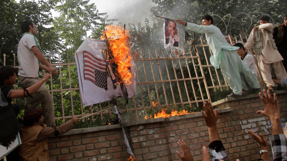 Afghans burn U.S. and Israeli flags in Kabul, Afghanistan, Sunday, Sept. 16, 2012. (AP / Ahmad Jamshid)