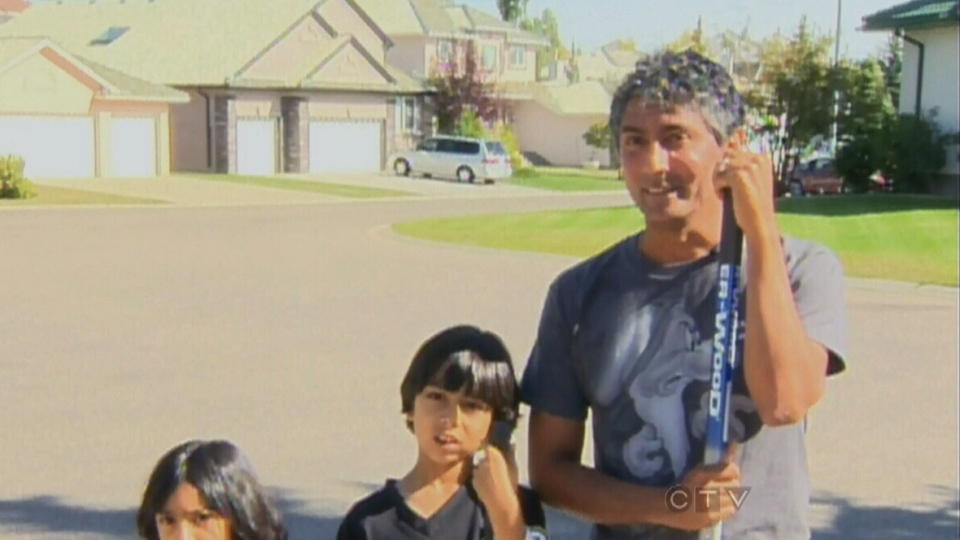Calgary eye doctor Arun Lakra and his children are seen in this image taken from video on Sunday, Sept. 16, 2012.