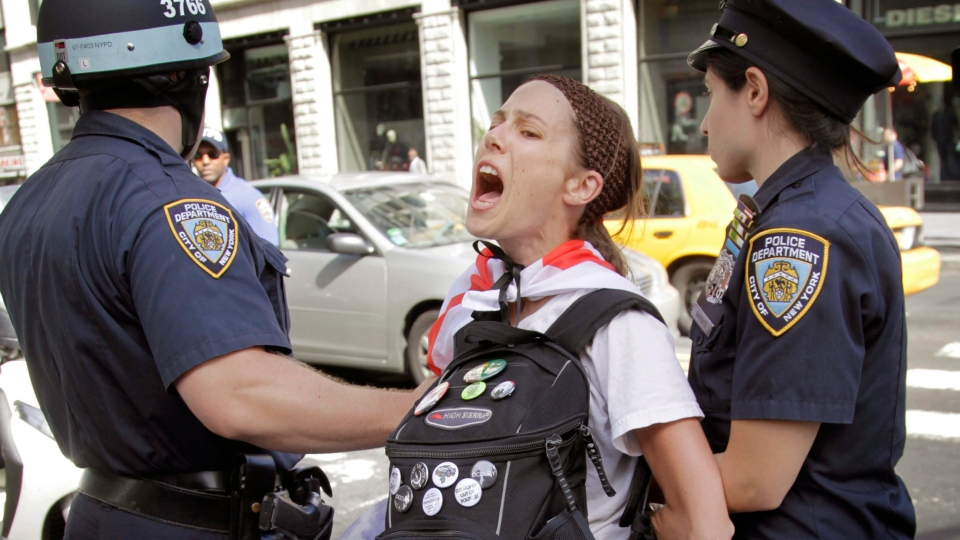 Police take Amanda Lodoza, an activist associated with the Occupy Wall Street movement, into custody during a march in New York, Sunday, Sept. 16, 2012. (AP / Seth Wenig)