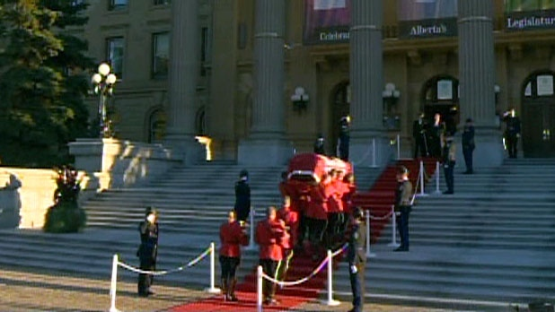 Peter Lougheed's body is brought into the Alberta legislature to lie in state, Sunday, Sept. 16, 2012.