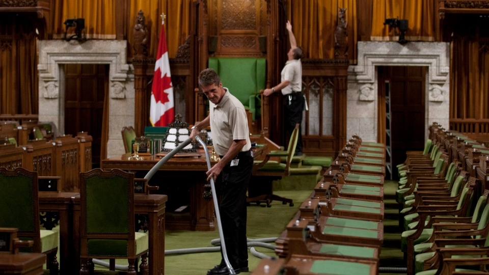 House of Commons maintenance staff Andre Dube, left, and Gilles Bourgon prepare the chamber for the return of Parliament in Ottawa on Friday, Sept. 14, 2012. A quiet summer has given Prime Minister Stephen Harper's Conservatives some breathing room as they head Monday into what could be an acrimonious fall sitting of Parliament. (Adrian Wyld / THE CANADIAN PRESS)