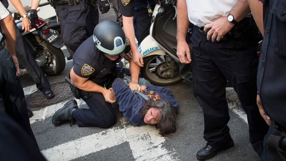 Anna Roblin is arrested during an Occupy Wall Street march, Monday, Sept. 17, 2012, in New York.  (AP / John Minchillo)