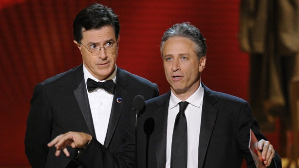 In this Sept. 21, 2008 file photo, Stephen Colbert, left, and Jon Stewart make an award presentation at the 60th Primetime Emmy Awards in Los Angeles. (AP Photo/Mark J. Terrill, file)