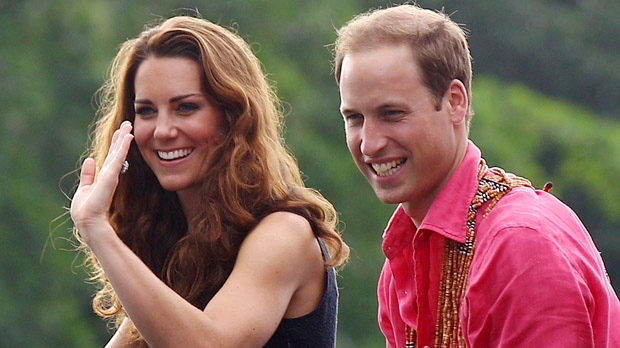 Prince William and his wife Kate, the Duchess of Cambridge, smile as they watch a shark ceremony as they arrive at Marapa Island, Solomon Islands on Monday, Sept. 17, 2012. (AP / Rick Rycroft)