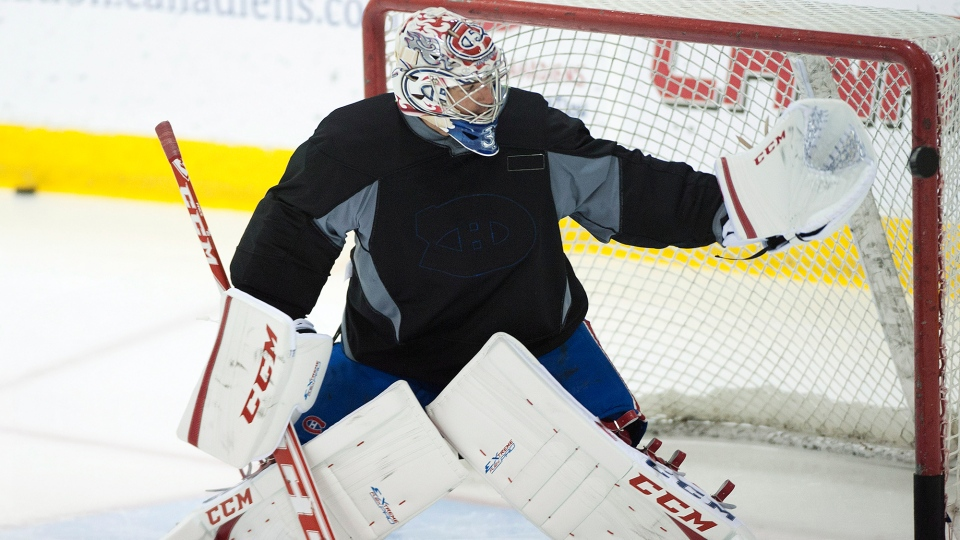 Montreal Canadiens' goaltender Carey Price makes a save during an informal training session at the Canadiens' training facility in Brossard, Que., Monday, Sept. 17, 2012. (Graham Hughes / THE CANADIAN PRESS)