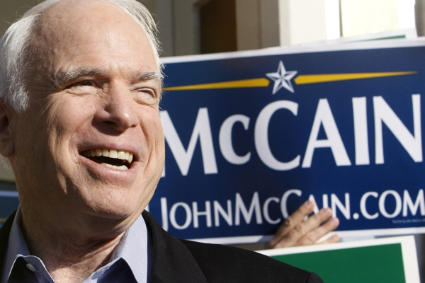 Republican presidential hopeful Sen. John McCain smiles while speaking to reporters outside a polling station in St. Petersburg, Fla. on Tuesday, Jan. 29, 2008. (AP / Charles Dharapak)