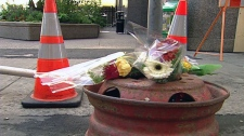 Flowers mark the site of a fatal collision at a temporary bus stop on Albert Street, Friday, Sept. 17, 2010.