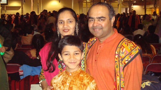 Jayesh Prajapati is seen with wife Vaishali and son Rishabh in this photo provided by a friend of the family.