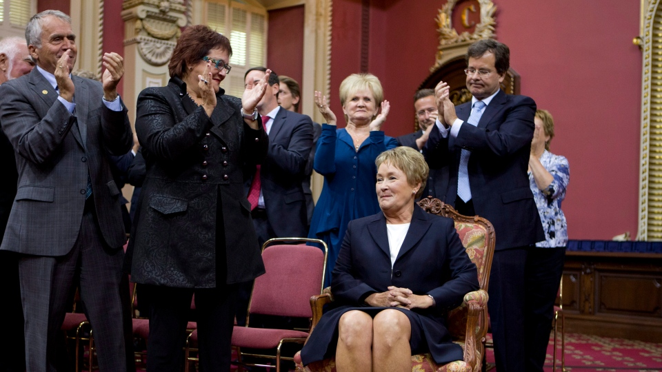 Premier-designate Pauline Marois smiles as members and people applaud her before she is sworn in as legislature member for Charlevoix-Cote de Beaupre during a ceremony where the 54 elected members of the Parti Quebecois are sworn in at the legislature in Quebec City on Monday, Sept. 17, 2012.  (Jacques Boissinot / THE CANADIAN PRESS)