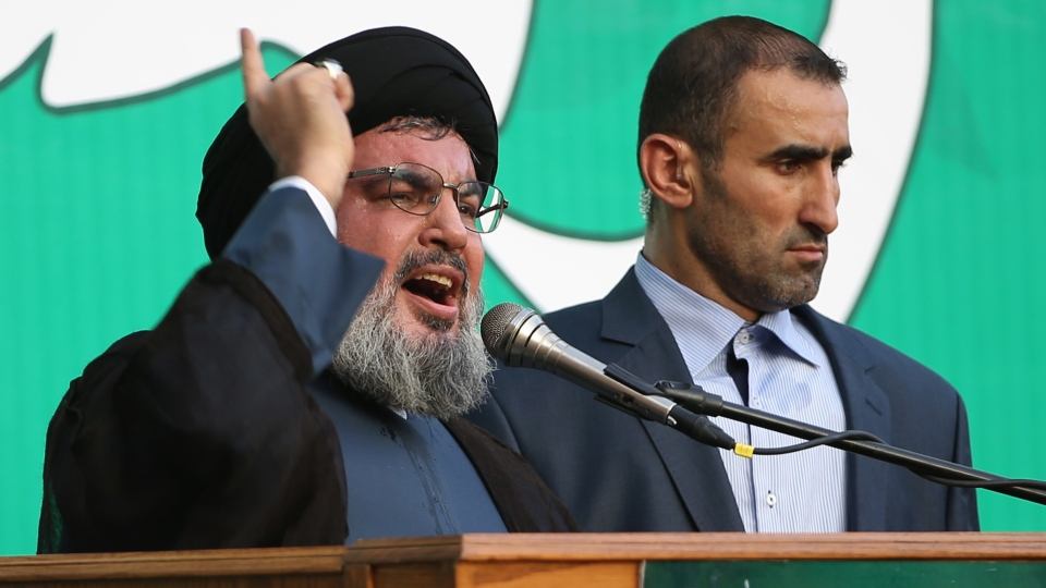 Hezbollah leader Sheik Hassan Nasrallah speaks during a rally denouncing an anti-Islam film, in the southern suburb of Beirut, Lebanon on Monday, Sept. 17, 2012. (AP / Hussein Malla)