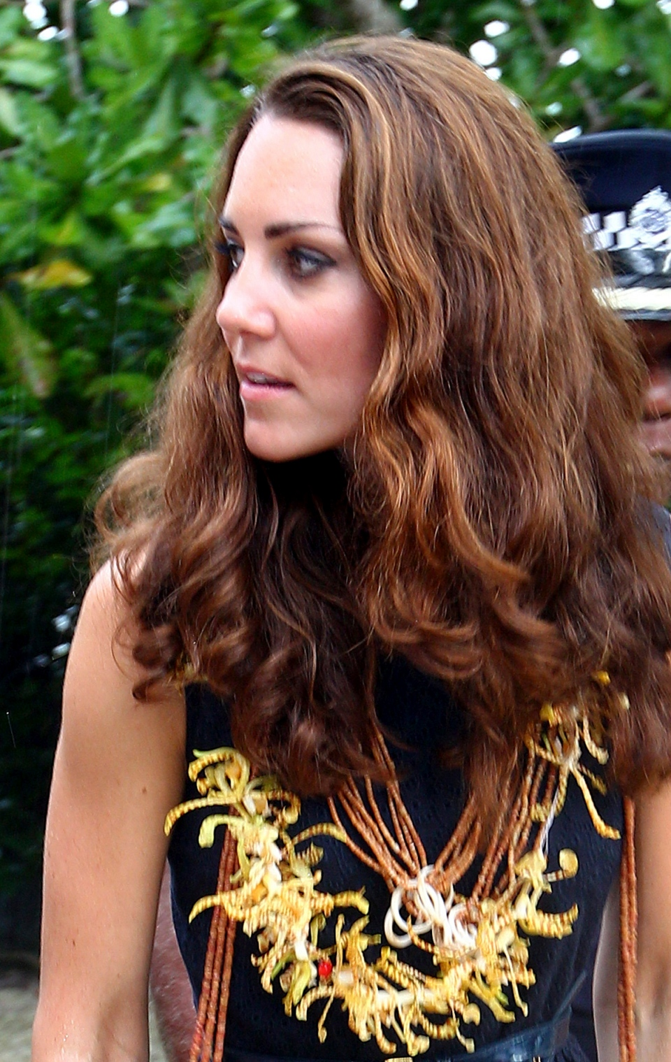 The Duchess of Cambridge, wears a garland of orchids as she arrives  with Prince William in Tavanipupu, Solomon Islands on Monday, Sept. 17, 2012. (AP /Rick Rycroft)