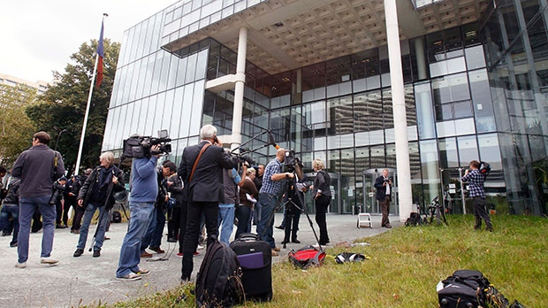 Members of the media gather outside a French court which ordered a magazine publisher to hand over all digital copies of topless photos of the Duchess of Cambridge and blocked the further publication of the images, in Nanterre, west of Paris, Tuesday Sept. 18, 2012.  (AP / Remy de la Mauviniere)