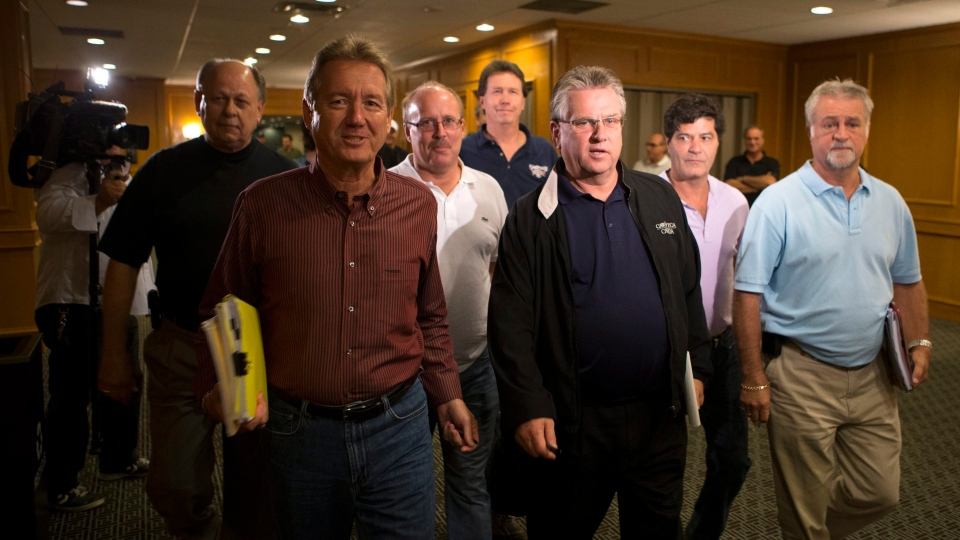Ken Lewenza, second right, president of the Canadian Auto Workers (CAW), arrives with members of the negotiating committee at a news conference in Toronto on Monday, Sept. 17, 2012 in which they announced a tentative deal with Ford. (Chris Young / THE CANADIAN PRESS)