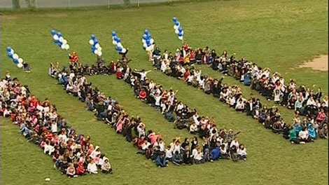 Students formed the number 100 on the grounds of Nesbitt Elementary to celebrate its centennial.