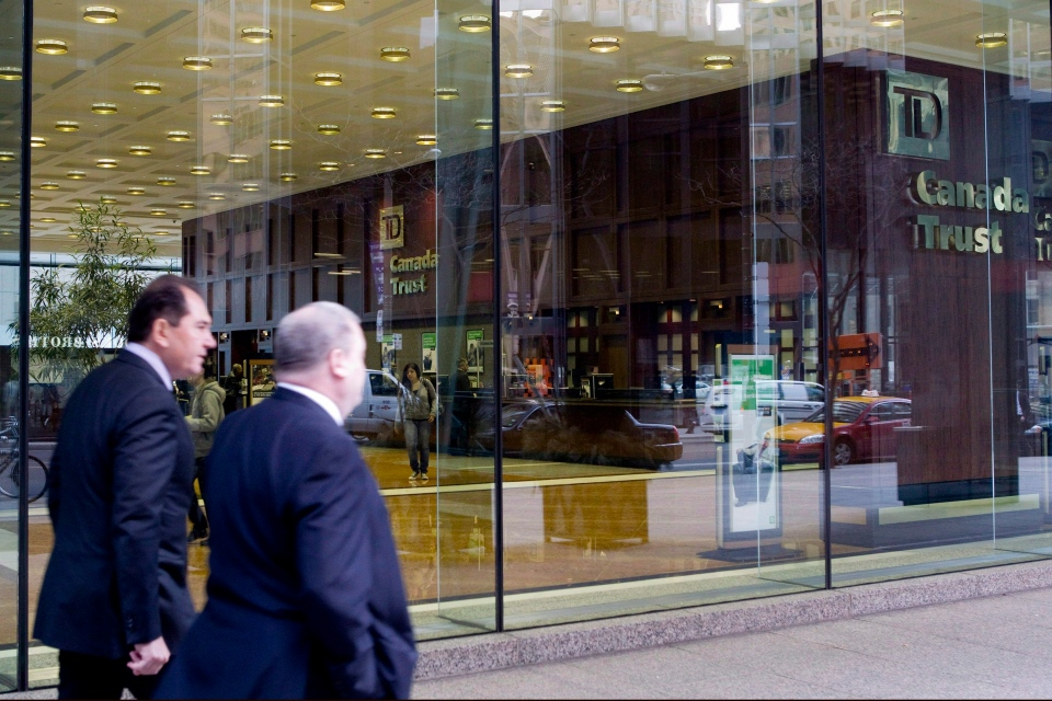 Two men walk past a TD-Canada Trust branch in Toronto.  (Chris Young / THE CANADIAN PRESS
