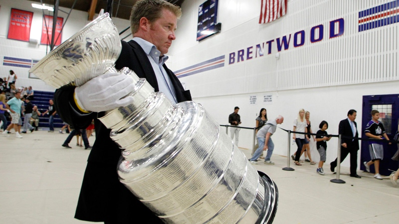 Tim Leiweke carries the Stanley Cup at Brentwood School in Los Angeles on Sept. 14, 2012.