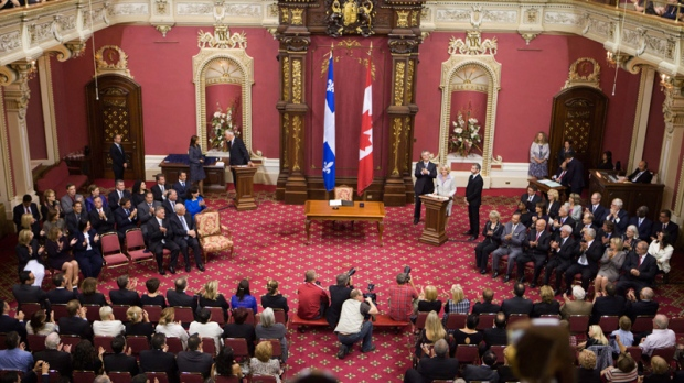 Quebec Liberal members are sworn in on  at the legislature in Quebec City on Sept. 18, 2012.
