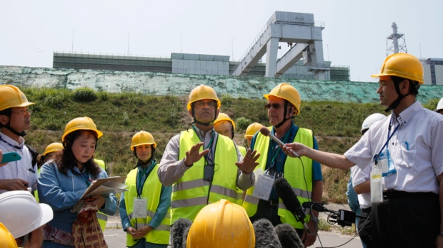 IAEA group head Sujit Samaddar, centre, speaks at the Onagawa nuclear power plant on July 31, 2012.
