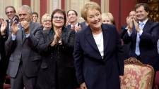 Quebec premier-designate Pauline Marois smiles as members and people applaud before she is sworn in