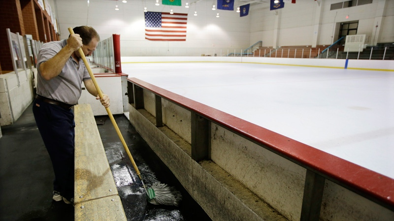 Tim Wilson cleans around a vacant Nashville Predators practice rink on Monday, Sept. 17, 2012, in Nashville, Tenn. (AP / Mark Humphrey)