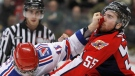 Kitchener Rangers', Tyler Randell, left, tries to hold back Windsor Spitfires', Harry Young, right, as they fight during second period OHL hockey action on Thursday, Feb. 11, 2010, in Windsor, Ont. (The Canadian Press/Greg Plante)