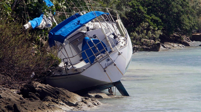 A boat lies aground near the public wharf in Somerset Village following Hurricane Igor's effects in Bermuda, Monday, Sept. 20, 2010. (AP / Gerry Broome)