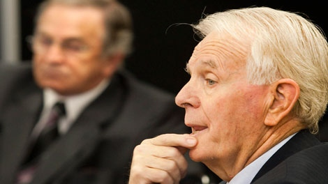Georges Lalande, former deputy justice minister from 2003 to 2005, testifies at the Inquiry Commission into the appointment process for judges Monday, September 20, 2010 in Quebec City. Quebec Liberal Party fundraiser Charles Rondeau, behind, waits his turn to testify. THE CANADIAN PRESS/Jacques Boissinot
