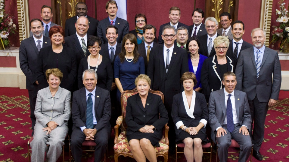 Quebec Premier Pauline Marois, centre, poses with members of her cabinet after she was sworn in behind closed doors by the lieutenant governor of the province, during a ceremony at the legislature in Quebec City, Wednesday, Sept. 19, 2012. (Jacques Boissinot / THE CANADIAN PRESS)