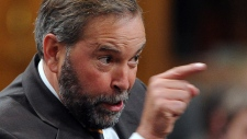 NDP leader Thomas Mulcair asks a question during question period