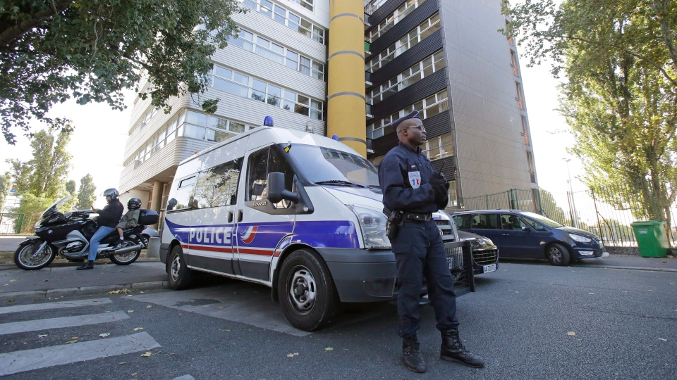 A French policeman stands guard outside the headquarters of the satirical weekly Charlie Hebdo in Paris on Wednesday, Sept. 19, 2012. (AP /MIchel Euler)