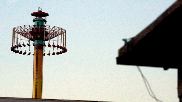 People on the Windseeker ride at Knott's Berry Farm are stuck a few hundred feet off the ground Wednesday, Sept. 19, 2012, in Buena Park, Calif. (AP Photo/The Orange County Register, Rod Veal)