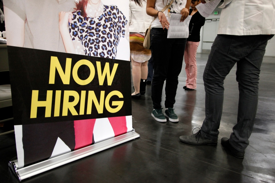 A job seeker talks to a recruiter at a job fair expo in Anaheim, Calif,  June 13, 2012 . The U.S. economy is showing signs of finally bottoming out. (AP / Jae C. Hong)