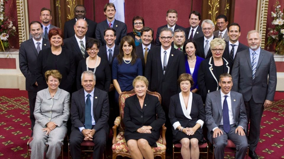 Quebec Premier Pauline Marois, centre, poses with members of her cabinet after she was sworn in behind closed doors by the lieutenant governor of the province, during a ceremony Wednesday, September 19, 2012 at the legislature in Quebec City. THE CANADIAN PRESS/Jacques Boissinot
