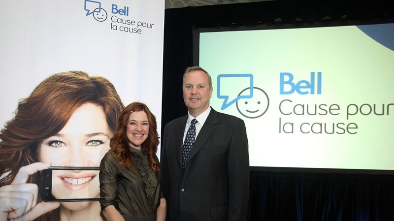 George Cope, President and CEO of Bell and BCE and Olympian Clara Hughes, at the launch of Bell's unprecedented, multi-year charitable program to support mental health across Canada in Ottawa, Tuesday, Sept. 21, 2010. (Bell Canada / The Canadian Press )