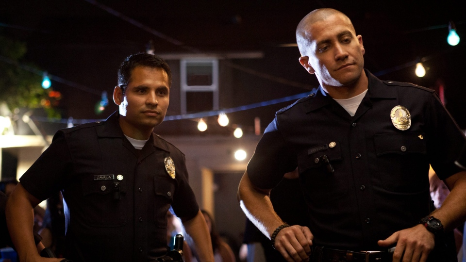 Michael Pena, left, and Jake Gyllenhaal in a scene from VVS Films' 'End of Watch.'