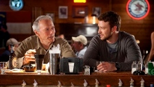 Clint Eastwood, left, and Justin Timberlake in a scene from Warner Bros. Canada's 'Trouble with the