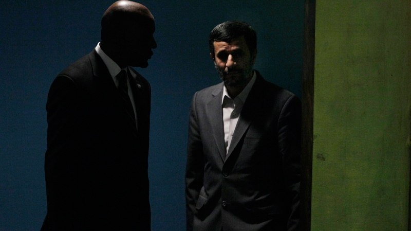 Mahmoud Ahmadinejad, right, president of Iran, is escorted to the podium to address a summit on the Millennium Development Goals at United Nations headquarters on Tuesday, Sept. 21, 2010. (AP / Richard Drew)