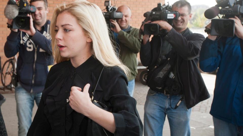 Maygan Sensenberger, the wife of Manitoba Senator Rod Zimmer, enters provincial court in Saskatoon, Thursday, Sept. 20, 2012. (Liam Richards / THE CANADIAN PRESS)