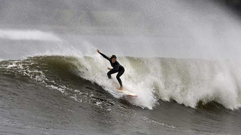 A surfer rides a wave at Cow Bay, N.S. on Monday, Sept. 20, 2010 as swells associated with hurricane Igor affect the Atlantic coast of Nova Scotia. A tropical storm warning has been issued for the coast of Newfoundland where people have been urged to prepare for possible flooding and power outages. THE CANADIAN PRESS/Andrew Vaughan