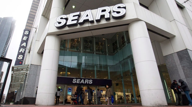 Shoppers leave the Sears store in downtown Vancouver, B.C., on Friday, March 2, 2012. (Darryl Dyck / THE CANADIAN PRESS)