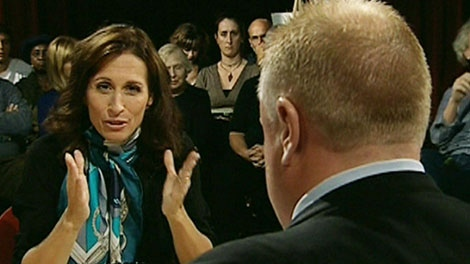 When asked what she and George Smitherman were whispering about, Sarah Thomson, left, explained that 'He was complimenting my scarf' during the CP24 debate on Tuesday, Sept. 21, 2010.