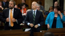 New Democratic Leader Jack Layton , middle, votes in the House of Commons on Parliament Hill in Ottawa on Wednesday Sept. 22, 2010. MPs have voted 153 to 151 to support a motion to kill Hoeppner's private member's bill that would have scrapped the registry. (Sean Kilpatrick / THE CANADIAN PRESS)