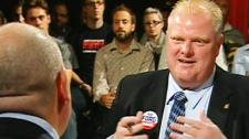 Rob Ford, right, and George Smitherman exchange jabs during a a CP24 debate on Tuesday, Sept. 21, 2010.