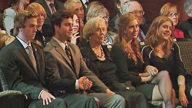 Jeanne Lougheed is surrounded by family members.