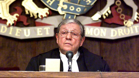 In this file photo, Ontario Chief Justice Roy McMurtry addresses a meeting in Toronto, Monday, Jan.10, 2000 (Kevin Frayer / THE CANADIAN PRESS)