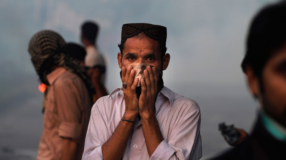 A Pakistani protester reacts to tear gas during clashes that erupted as the demonstrators tried to approach the U.S. embassy in Islamabad, Pakistan, Friday, Sept. 21, 2012. (AP / Anjum Naveed)