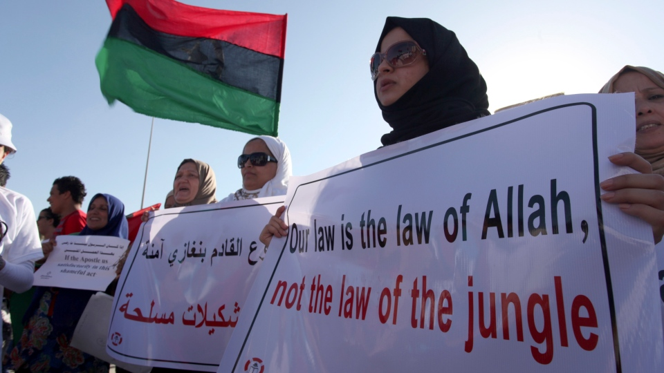 Libyan women protest against Ansar al-Shariah Brigades and other Islamic militias in front of the Tebesty Hotel, in Benghazi, Libya, Friday, Sept. 21, 2012. (AP / Mohammad Hannon)